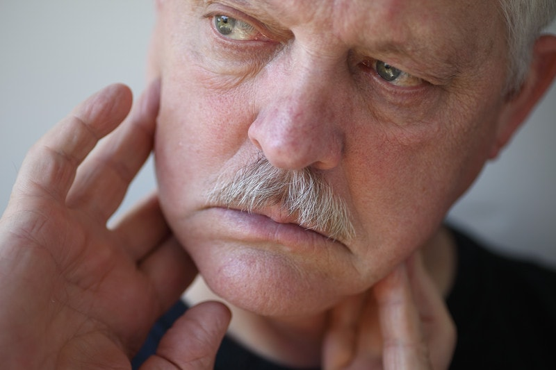man with TMJ pain in the lower jaw